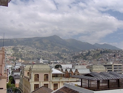View of the city of Quito nestled against a backdrop of mountains, from the Monestario de Santa Catalina