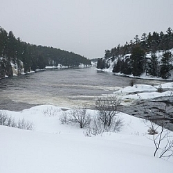 Snowshoe hiking to French River's Récollet Falls surprised us — we expected the water to be frozen!