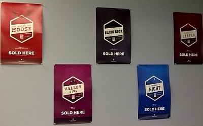 Posters of various Stack Brewing beers