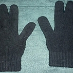Layering winter wear for warmth with thin stretchy gloves.