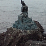 A replica of The Little Mermaid statue, erected in front of APEC House near Busan's Haeundae Beach.