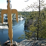 A totem pole looks over the French River at Dokis First Nation.