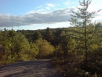 Panoramic view from a hilltop on Jurassic Road in the French River area.