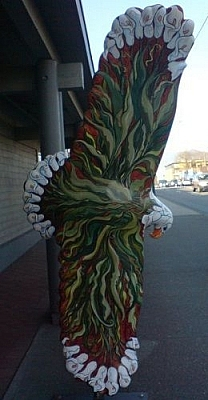 Tribal eagle sculpture colourfully painted.