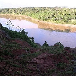 Scenic view of a Tambopata area river winding its way into the Amazon rainforest of Peru.
