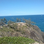 View of the ocean from Noosa National Park, a rocky point jutting out towards the sea.