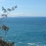 Scenic view of the ocean from Noosa Park, small mountains just visible in the background.
