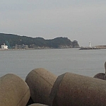 View of the Dadaepo shipyard and Dusongsan Peninsula from one of the docks across the bay.