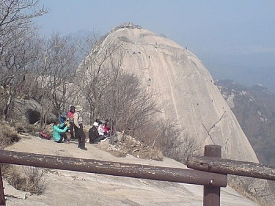 Watching free climbers on the opposite peak at Bukhansan National Park.