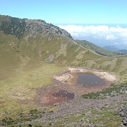 A volcanic crater at Hallasan National Park, containing only a little water at the time of my visit.