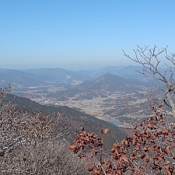 A city seen from a hilltop at Jogyesan Park.