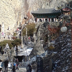 A temple complex built into the cliffside at Maisan Park.