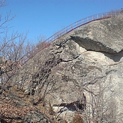 A more reassuring view of a staircase built on a steep, rocky hillside.