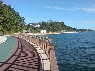 Walking along the seashore boardwalk in Tongyeong.