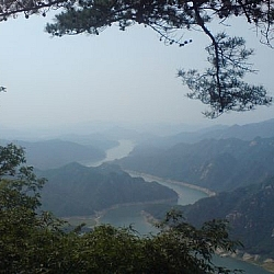 A winding river-like lake seen from Woraksan National Park.