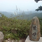 The peak marker and mountain scenery at Yeonhwasan Park.