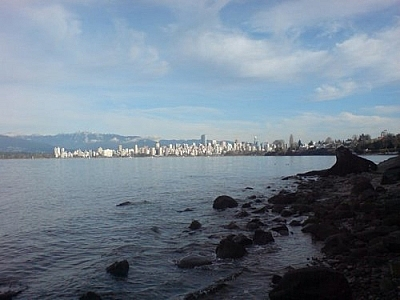 The Pacific Ocean and the downtown skyline with a mountainous backdrop, as seen while exploring Vancouver.