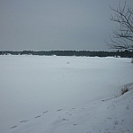 View of Lake Nipissing while snowshoe hiking Mashkinonje Park at Lapin Beach.