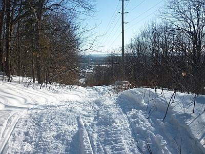 Snowmobile tracks along the Richardson Ridge Trail.