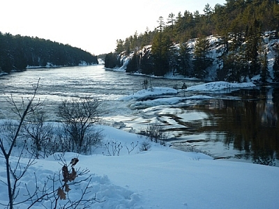 Snowshoeing along French River to Récollet Falls yields this view of the historical site.