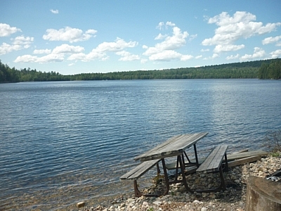 Picnic table on the shore of Christman Lake, Mississagi Park.