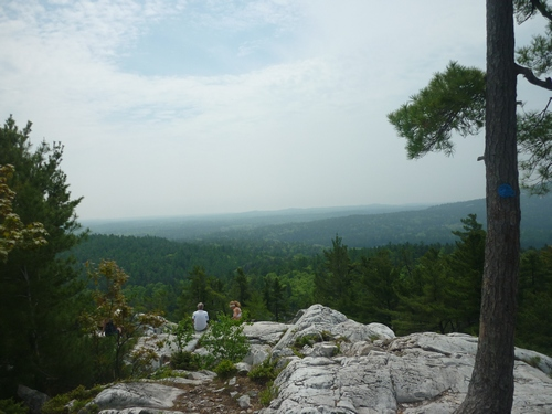 Day hikers enjoying the panoramic scenery at The Crack, Killarney Provincial Park.