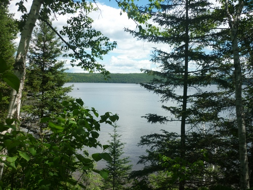 A boat just visible in the distance on Lake Temiskaming...