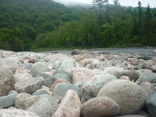 Close-up view of the rocky Agawa River shoreline.
