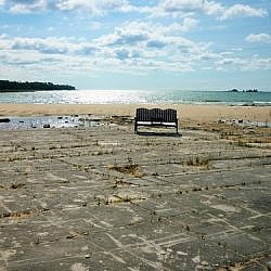 A bench overlooking Misery Bay sits on a stretch of coastal alvar pavement.